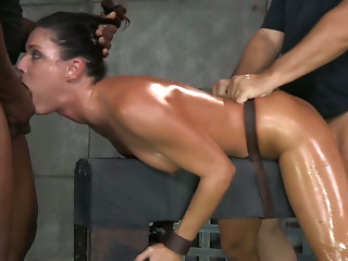 Fit oiled MILF India Summer gets shackled down and used hard by 2 dudes