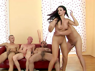 Cum-addicted nympho sucks several cocks at once in wild gangbang scene