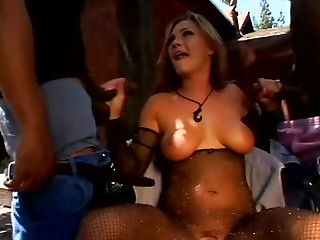 Sexy buxom tanned blondie in fishnet stuff Venus sucks two dicks outdoors (MMF)
