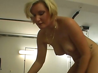 Curvaceous blonde bombshell rubs her meaty pussy with her fingers