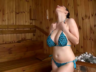 Awesome sexy and hot busty brunette poses on cam in the sauna