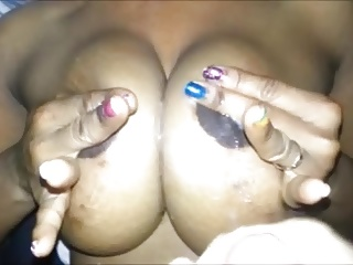 Coating big Haitian MILF tits in white cum