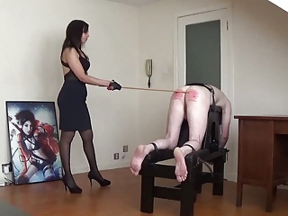 Hard caning from Miss Sultrybelle.