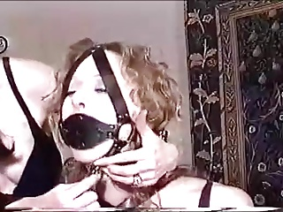 Redhead in Black Leather Armbinder and Plug Ballgag