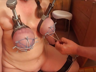 tortured her tits with rubberbands