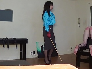 Miss Sultrybelle administers 70 strokes.
