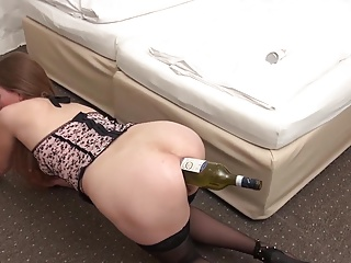 Amateur gaping asshole with bottle of wine