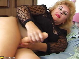 Sassy mature granny spreading legs while masturbating