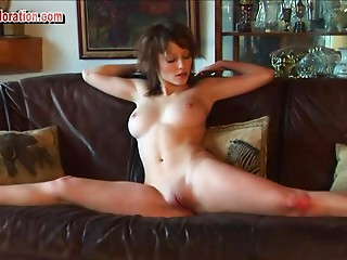 Flexible brunette solo model passionately displays her shaved pussy