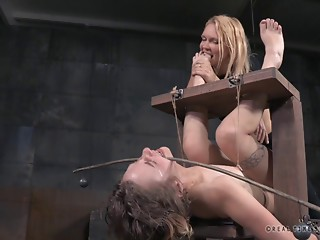 Horny bimbo simply enjoys being restrained in the dungeon