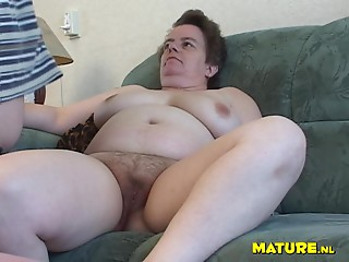 Mature dame tits fondled when her pussy is licked on sofa