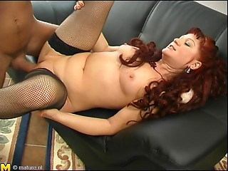 Yells as matured dame is stockings is penetrated hardcore on sofa