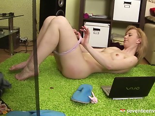 Blonde girl gets horny watching porn & rubs her aching cunnie