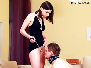 Charming babe in high heels stepping on her slave in BDSM shoot