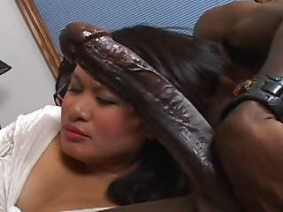 Pretty Asian girl sucks the biggest ebony cock that she has ever seen