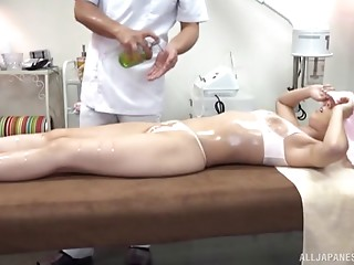 Sweater girl gets a massage and enjoys sex with the masseur