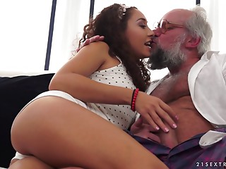 Hypnotic curly chick riding the dick of the experienced guy