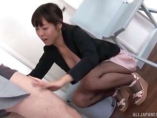 Helpful Asian businesswoman gives her co-worker head