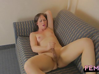 Tranny on the couch with her legs spread and stroking solo