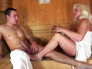 Granny fucking in the sauna with a hard cock stud