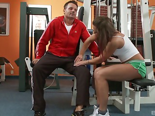 A personal trainer helps her work out by hammering her pussy