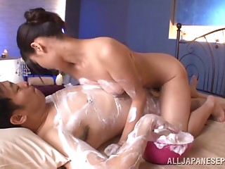 Enticing Asian maiden getting soaped before being fucked hardcore on bed