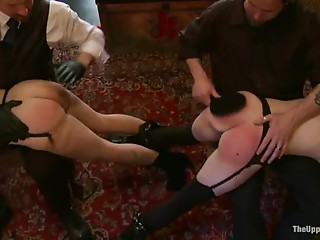Two hot chicks get tied up, spanked and fucked indoors