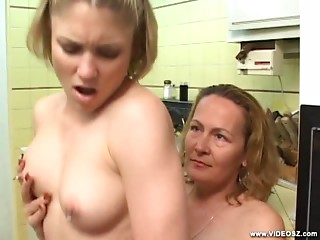 Horny Mature Bangs Young Pussy With A Strap On Dildo