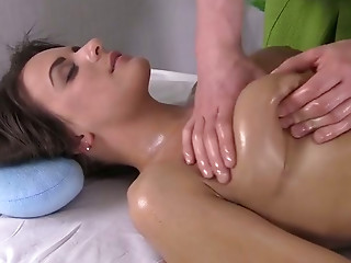 Lucky masseur massages sexy boobies and thighs of charming brunette