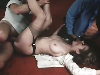 Stunning vintage porn actress Veronica Hart is fucked by two dudes on the floor